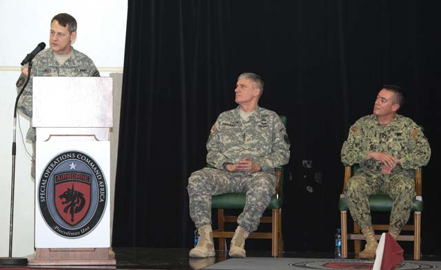 Martin Greeson Incoming SOCAFRICA commander Army Brig. Gen. James B. Linder (left) addresses the audience during a change of command ceremony June 7 at Kelley Barracks. Gen. David M. Rodriguez (center) presided over the ceremony in which Rear Adm. Brian L. Losey (right) relinquished his command.