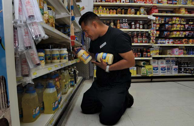 Estiban Vela, a Panzer Commissary store associate, stocks shelves June 10. Furloughs will impact Vela and the rest of DeCA's 14,000 U.S. civilian employees. When furloughs are implemented, most military commissaries will close one day a week on Mondays.