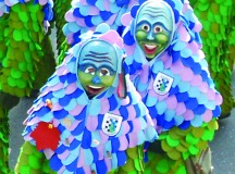 """Members of the Hofener Scillamännle Fasching guild in Stuttgart-Hofen participate in last year's parade in Hofen. The guild was founded in 1985 and the group is named after the """"Blaustern,"""" or scilla flower, which grows in the environmentally-protected """"Scillawald"""" area near Hofen. The mask of the Scillamännle is made of lime-tree wood. The mask and """"Häs,"""" or costume, is made based on the blossom and leaf colors of the scilla plant. This year's parade in Hofen will be held Feb. 17 at 1 p.m. Photo by Carola Meusel, USAG Stuttgart."""
