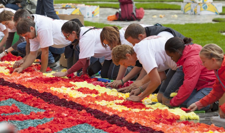 """""""Fronleichnam,"""" or Corpus Christi, is observed May 26 and is a federal holiday in Germany. Creating colorful flower carpets is one of many treasure traditions on Fronleichnam. Photo by Shutterstock.com."""