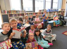 Heather Tibodeaux's kindergarten class read books together in the library of Stuttgart Elementary School dressed in pajamas joined the rest of Stuttgart Elementary School in recognizing Red Ribbon Week by dressing up in their favorite PJ's and wearing them to school, Oct. 24. Red Ribbon Week has been recognized since 1985 in remembrance of Enrique Camarena who died in the line of duty fighting the use of drugs in America. Every day this week, students pledge remain drug free in a different and creative way. Photo by Daniel L'Esperance