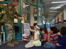 Col. Glenn K. Dickenson, garrison commander, reads a Dr. Seuss book to students at Robinson Barracks Elementary School, March 10, 2017. Photo by Holly DeCarlo-White.