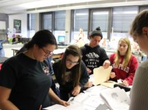 SHS students sift through evidence to solve a simulated crime practical, March 3. The junior sleuths received a week of training in forensic science from a Stuttgart CID agent.