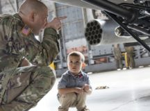 U.S. Army Col. Jeff A. Becker captures the attention of a little boy before a welcome home ceremony on Hunter Army Airfield. Army photo by Sgt. William Begley
