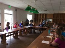 Robinson Barracks community members meet at the former bar space June 14, 2017 to discuss the opportunity for volunteers to take over the space. Photo by Holly DeCarlo-WHite