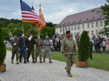 A joint German-American color guard advances to begin the U.S. Army Garrison Stuttgart change of command ceremony, July 12, 2017. Col. Neal A. Corson assumed command from Col Glenn K. Dickenson in a ceremony on Washington Square, Patch Barracks. Photo by John Reese, USAG Stuttgart Public Affairs