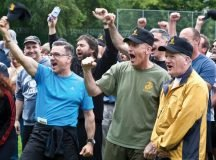 "Members of the U.S. Africa Command J5 directorate display their enthusiasm to win the AFRICOM Olympics Spirit Award, following AFRICOM's first ""Olympic"" gaming event July 15 on Kelley Barracks, U.S. Army Garrison Stuttgart. Photo Credit: Joseph Mancy"