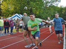 Brenda Law  Runners pass the baton during the 400-meter relay, the first event of the third annual AFRICOM  Olympics held Aug. 22 on Kelley Barracks. More than 1,600 people participated in the games.