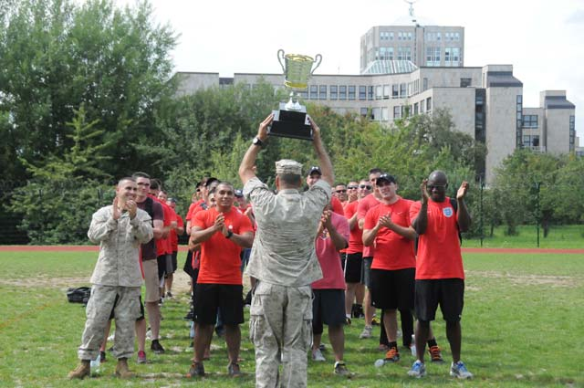 Photo by Chief Petty Officer Mark Richardson, USAFRICOM Public Affairs.Gunnery Sgt. Daniel Hernandez presents the fourth annual AFRICOM Olympics trophy to fellow Marines July 8 following the all-day competition held at Kelley Barracks. MARFORAF beat out nine other teams in 21 different events to take the overall title.