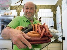 Mannfred Hähnle, master butcher and proprietor of Hähnle Butcher and Catering in Böblingen, displays a tray overflowing with smoked sausages, bratwursts and the local regional favorite, Seitenwurst, which is very similar to the frankfurter.— Photo by Greg Jones, USAG Stuttgart Public Affairs Office.