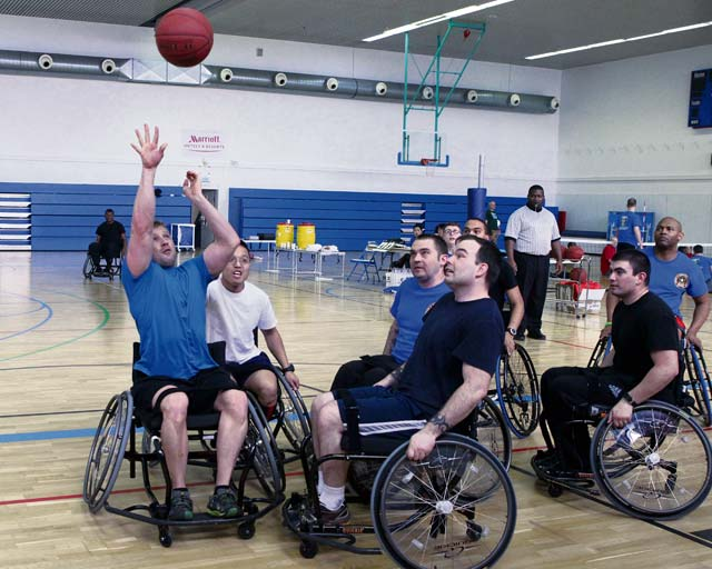 Photo by Linda SteilThe Warrior Transition Unit composite team (in blue) battles against a team representing the Special Operations Command in a game of wheelchair basketball Feb. 28 during an adaptive sports tournament sponsored by the Warrior Transition Battalion-Europe.