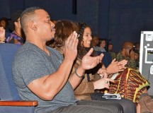 Photo by Greg JonesAudience members clap along during a rousing musical performance at USAG Stuttgart/AFRICOM Black History Month celebration at Kelley Theater Feb. 27. The celebration included musical and spoken word performances, a historically themed keynote address, and a sampling of African-American cuisine.