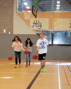 Photo by Carola MeuselAlma Hasanbasic (from left) and Aria Emir, eighth graders at Johannes-Kepler-Gymnasium in Bad Cannstatt, along with Patch High School ninth-grader Sean Loeben, practice dribbling basketballs during physical education in the PHS gymnasium Feb. 25, as part of a school outreach program.