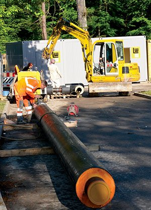 S.J. Grady Workers prepare insulated pipes before they are installed underground May 23. About 6,000 meters of pipes will be replaced on Panzer Kaserne.