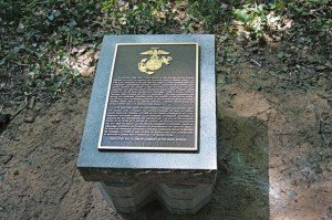 Photo by Bill Beaman A plaque rests on its pedestal. Kullen Langston's Eagle Scout service project raised the plaques off the ground to prevent them from decaying or being stolen.
