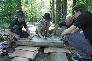 Photos by Bill Beaman Kullen Langston (center), 16, an Eagle Scout candidate, marks dimensions on a plaque before it gets placed on a pedestal at the Belleau Wood, France, battlegrounds July 13. Assisting him are assistant Scoutmaster and father, John (far left), assistant Scoutmaster Jeremiah Idell (from Kullen's right) and fellow Life Scout Joey Paul.