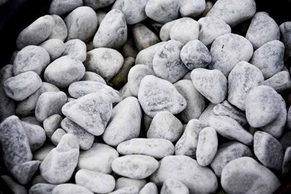 In Jewish tradition, simple white stones are used instead of flowers to ornament gravesites. The intent is to maintain a somber environment.