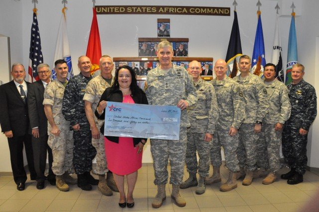 Ms. Adams & Gen Rodriguez (Commander SAFRICOM) are holding the check surrounded by AFRICOM's senior leadership. Photo credit: USAFRICOM Public Affairs Office (POC: Ms Brenda Law).