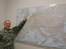 SPC Arica Wilson from the 587th Signal Company shares the new Travel Bucket List map as part of the Patch Barracks living quarters improvements. Photo by Stuttgart Family and MWR.