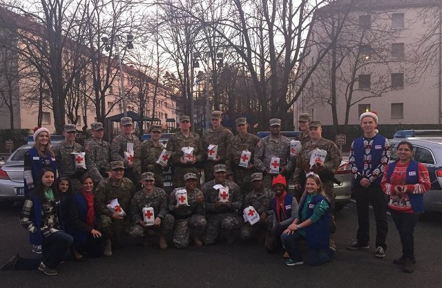 The American Red Cross partnered with Amazon gifting packages filled with goodies to men and women in uniform working on Christmas Day including the 554th Military Police Company on Panzer Kaserne, Dec. 25, 2015.