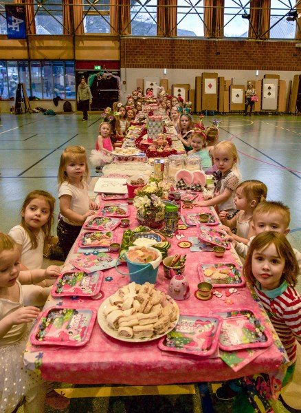 "60 students have a ""Mad Hatter Tea Party"""