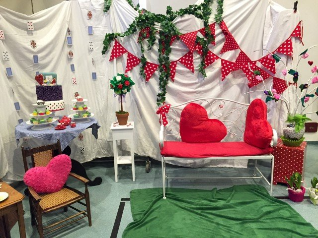 """During the SKIES Dance Production Theater """"Mad Hatter Tea Party"""" rehearsal held Feb. 24, 2016, students had an opportunity be professional photographed in front of a backdrop made entirely by parent and student volunteers of the Stuttgart military community."""