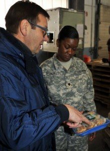 Photo Credit: Mr. Gino G Mattorano (Army Medicine) Gerald Fasching, a supervisory quality inspection specialist, and Spec. Keturah Branch, a veterinary food inspection specialist, perform a spot check on food arriving at the Kaiserslautern Cold Storage Facility March 3. Spot checks ensure that food items have remained at correct temperatures during transport. Fasching and Branch are both assigned to Public Health Command Europe.