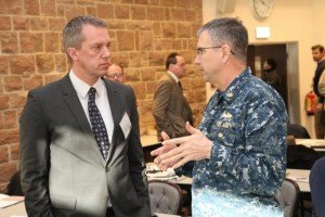 Dave Colberg, left, a U.S. Army Corps of Engineers Europe District program manager, discusses an issue with Navy Capt. Rod Worden, chief of AFRICOM's Logistics Support and Engineering Division, during the USACE Partner Workshop. The sixth annual forum took place Feb. 17 at Clay Kaserne in Wiesbaden, Germany.