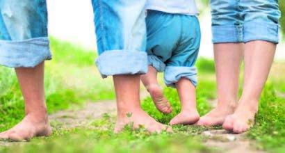 feet in grass spring barefoot park