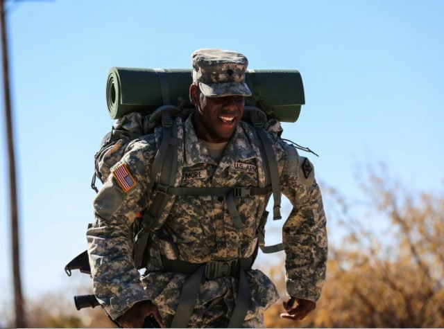 U.S. Army Spc. Samuel Latimore, attached to 52nd Signal Battalion, finishes the last stretch of the ruck march during the 2016 Network Enterprise Technology Command Best Warrior Competition held at Fort Huachuca, Ariz., June 14, 2016. The competition is a grueling weeklong event that tests the skills, knowledge, and professionalism of 10 warriors representing the 5 commands within NETCOM. (U.S. Army photo by Pfc. Michael Parnell/Released)