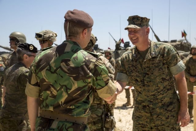 Photo By Staff Sgt. Tia Nagle | General Frederico Rovisco Duarte, Portuguese Army Chief of Staff, thanks U.S. Marine Corps Lt. Col. Sean Wilson, operations officer of the Special Purpose Marine Air-Ground Task Force-Crisis Response-Africa, for the Marines' participation in Exercise Orion 16 at Campo Militar de Santa Margarida, Portugal, July 2, 2016. The Portuguese military invited distinguished visitors from various countries for a demonstration from Portuguese and American forces to conclude Exercise Orion 16. (U.S. Marine Corps photo by Staff Sgt. Tia Nagle/Released)