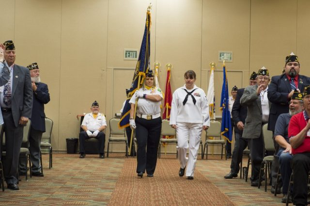 Yeoman 1st Class Brenda Belcher, a Washington native, assigned to AFRICOM in Stuttgart, Germany, walks down the aisle during the 4th annual American Legion Department of Washington Spirit of Service Award (SOSA) in Centralia, Washington, July 15. The SOSA is awarded to outstanding military professionals who are actively engaged in the community through volunteer projects. U.S. Navy photo by Mass Communication Specialist 2nd Class Jacob G. Sisco.