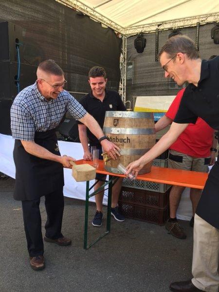 Garrison Commander taps first keg at local fest