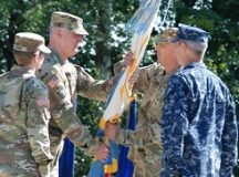 Col. Andrew S. McClelland receives the colors from the Defense Information Systems Agency- Europe Director, Lt. Gen. Alan R. Lynn, during a change of command ceremony on Patch Barracks, July 8, 2016. McClelland assumes command from Col. Jacqueline D. Brown. Photo by Master Sgt. Anthony O'Brien, DISA-Europe