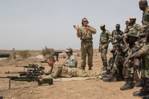 U.S. Army Master Sgt. Mac Broich, an instructor with the Vermont National Guard, instructs Senegalese soldiers at an advanced marksmanship range in Thies, Senegal, as part of Africa Readiness Training 16, July 17, 2016. The exercise is designed to increase U.S. and Senegalese readiness and partnership. U.S. Army photo by Spc. Craig Philbrick