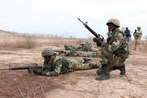 Senegalese soldiers with the 1st Paratrooper Battalion provide security during a platoon live-fire exercise as U.S. Army soldiers of 1st Battalion, 30th Infantry Regiment, 2nd Infantry Brigade Combat Team, 3rd Infantry Division observe in Thies, Senegal, as part of Africa Readiness Training 16, July 21, 2016. The exercise is one of many on the continent. U.S. Army photo by Staff Sgt. Candace Mundt