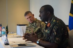 Army Maj. Gen. Joseph Harrington, U.S. Army Africa commanding general, listens to opening remarks provided by Tanzanian Brig. Gen. Jairos Mwaseba, Land Force Training Officer, during the Eastern Accord 2016 Regional Leaders Seminar held in Dar es Salaam, Tanzania, July 21, 2016. U.S. forces engage with African forces at all levels. U.S. Army photo by Capt. Jason Welch
