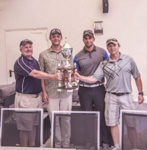 Team members of Special Operations Command Africa, (left to right) Bill Vasios, Richard Romine, John Childers and Shawn Kauffman, hold the winning trophy at the Commanders Cup Golf Tournament, Aug. 13, 2016 at the Stuttgart Golf Course in Kornwestheim. Photo by Severin Hardy.