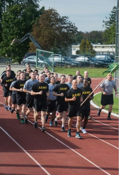 Col. David J. Segalla, Jr., division chief, ACJ34, U.S. Africa Command leads Soldiers from across U.S. Army Garrison Stuttgart in the final lap of the U.S. Army Military Police Corps' 75th Anniversary Regimental Run, Sept. 28, 2016 at Husky Field on Patch Barracks in Vaihingen, Germany. U.S. Army Photo by Martin Greeson.