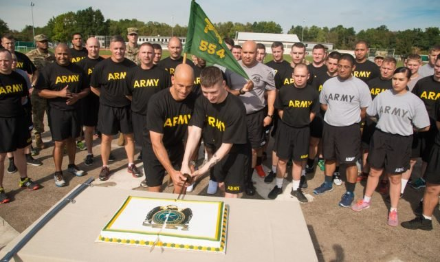 "Col. David J. Segalla, Jr., division chief, ACJ34, U.S. Africa Command (left) and youngest Soldier in formation, Pfc. Tanner Bedell of the 3rd Platoon ""Hooligans"" from the 554th Military Police Company cut the celebratory cake to close the 75 km run honoring the U.S. Army Military Police Corps' 75th anniversary Sept. 28, 2016 at Husky Field on Patch Barracks in Vaihingen, Germany. U.S. Army Photo by Martin Greeson."