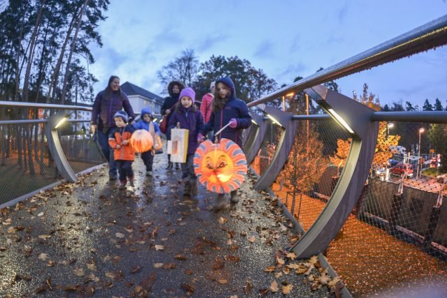 Families walk with lanterns across the pedestrian bridge on Panzer Kaserne to celebrate the German holiday, St. Martin's Day, Nov. 10, 2016. Photo by Kevin S. Abel.