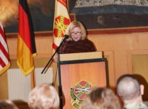 Tawania Kovacs addresses to the audience at the USAG Stuttgart Women's History Month, March 22.
