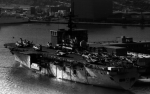 The USS Guam (LPH-9), an Iwo Jima-class amphibious assault ship, shown dockside in Barcelona Harbor following the accident, Jan. 30, 1977. The Guam was decommissoned in 1998 and served as a target for a SINKEX, Oct. 16, 2001. Photo by Fabio Pena.
