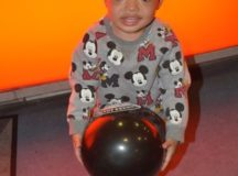"""Little Micah Street attends the CAPM """"Strike Out Child Abuse"""" pizza and bowling party, April 13, 2017. Photo by John Reese, USAG Stuttgart Public Affairs"""