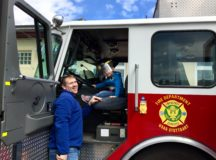 Everitt Harvey sits in the USAG Stuttgart Fire Department's fire truck outside Patch Barracks Fitness Center with his father during the spring MOMC festival, April 29.