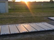 As the sun sets, it shines on the white rocks that adorn the graves at the Holocaust Memorial located at the main gate of the Stuttgart Army Airfield. Photo by Larry Reilly
