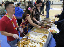 Kelley Barracks Commissary employees serve food during an event supporting Asian-Pacific History Month. This store won DeCA's Best Small Commissary Overseas. (DeCA photo)