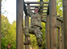 SGT Susi Stuttgart Army Medical Clinic negotiates the Tarzan obstacle that test soldiers balance and strength and stamina in the Boeblingen training area Boeblingen, Germany, Sep. 28, 2017. (U.S. Army photo by Visual Information Specialist Martin Greeson)
