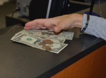 A bag of assorted coins is transformed into mostly paper money. Customers bring a receipt from the counting machine to the teller, who pays out the amount or, for Community Bank customers, deposits it into their account. Photo by John Reese, USAG Stuttgart Public Affairs