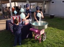 Volunteer Ryan Scholl distributes cotton candy as USO Center manager Sarah Kemp spins more cones at Patch Elementary, School's 2017 Harvest Fest. Photo by John Reese, USAG Stuttgart Public Affairs